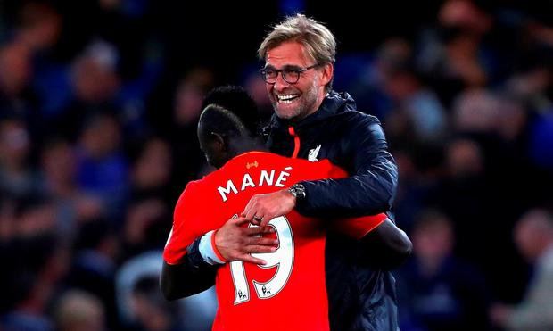 Sadio Mane of Liverpool and Jurgen Klopp, Manager of Liverpool celbrate victory in the Premier League match between Chelsea and Liverpool at Stamford Bridge