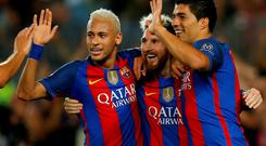 Lionel Messi, center, celebrates with his teammates Luis Suarez, right, and Neymar during the rout of Celtic