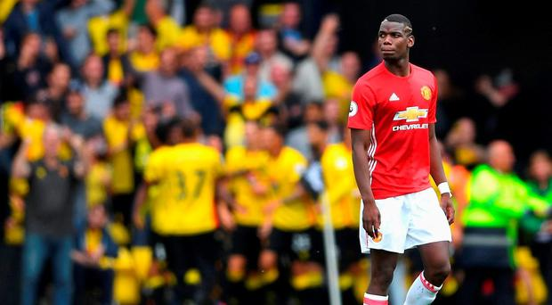 Paul Pogba of Manchester United reacts as Watford score during the Premier League match at Vicarage Road