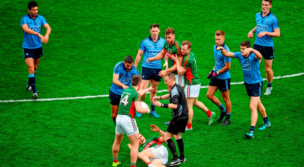 Dublin players Cian O'Sullivan, James McCarthy, and Diarmuid Connolly, signal to referee Joe McQuillan