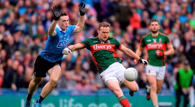 Andy Moran of Mayo in action against Brian Fenton of Dublin