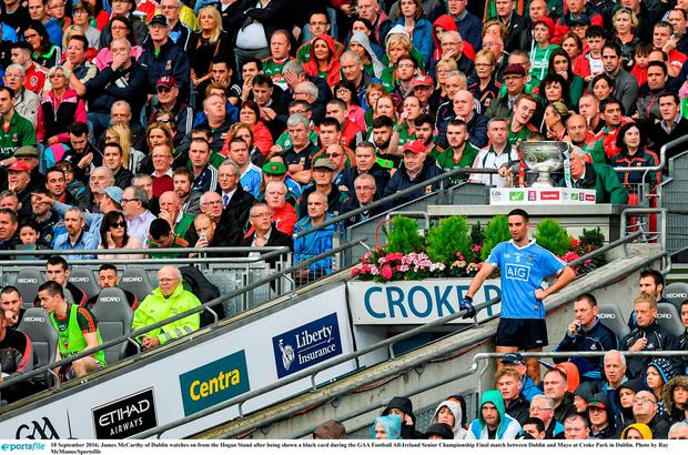 James McCarthy of Dublin watches on from the Hogan Stand after being shown a black card during the GAA Football All-Ireland Senior Championship Final match between Dublin and Mayo at Croke Park in Dublin. Photo by Ray McManus/Sportsfile