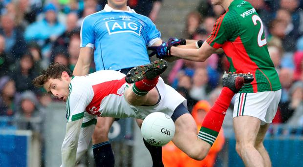 Mayo's Keeper David Clarke and Brendan Harrison in action with Dublins Bernard Brogan during the AllIreland Final
