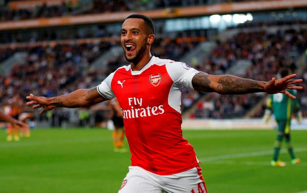 Arsenal's Theo Walcott celebrates scoring their second goal. Photo: Russell Cheyne/Reuters