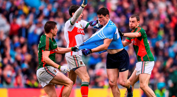 Diarmuid Connolly of Dublin tussles with Lee Keegan, left, David Clarke, second from left, and Keith Higgins, right, of Mayo