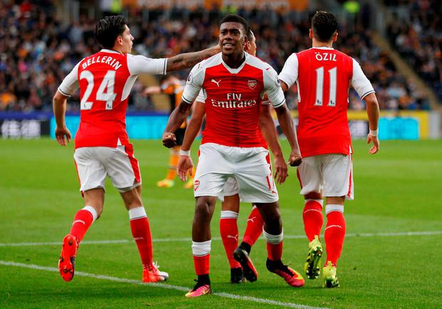 Arsenal's Alex Iwobi celebrates after Theo Walcott scores their second goal. Photo: Russell Cheyne/Reuters