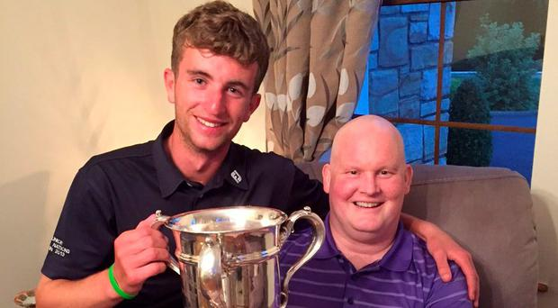 Co Sligo's Sean Flanagan with the late Mark Rooney. Flanagan (left) won the North of Ireland Amateur title in July and his first port of call before going to the golf club on his return was to see a 'delighted' Rooney and show him the trophy.