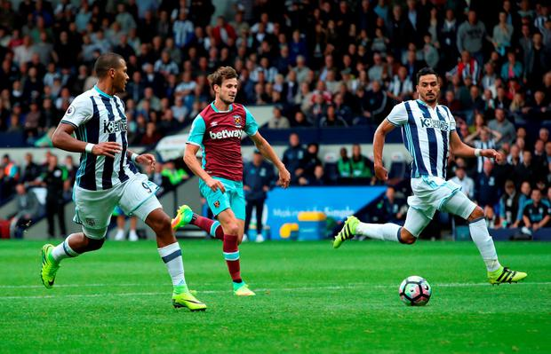 West Bromwich Albion's Jose Salomon Rondon (left) provides the assist for Nacer Chadli's fourth goal of the game. Photo: Nick Potts/PA Wire.