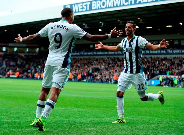 West Bromwich Albion's Nacer Chadli (right) celebrates scoring his side's fourth goal. Photo: Nick Potts/PA Wire.