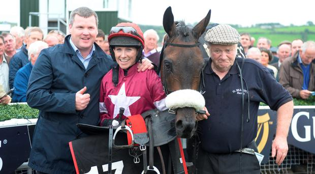 Highflying trainer Gordon Elliott with jockey Lisa O'Neill in the winner's enclosure after she had guided his Wrath Of Titans to victory in Wednesday's Guinness Kerry National at Listowel. Photo: Don MacMonagle