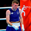 Paddy Barnes looks dejected after his light-flyweight preliminary round defeat to Spains' Samuel Carmona Heredia – he is now joining the pro ranks. Photo by Stephen McCarthy/Sportsfile