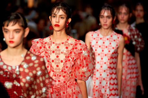 Models present Simone Rocha's creations at her spring/summer catwalk show at London Fashion Week. Photo: Getty Images