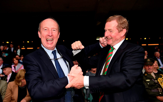 Transport Minister Shane Ross from Dublin spars with Taoiseach Enda Kenny, who sported a tie in the colours of his home county Mayo, in the stands at yesterday's all-Ireland final in Croke Park. Photo: Sportsfile
