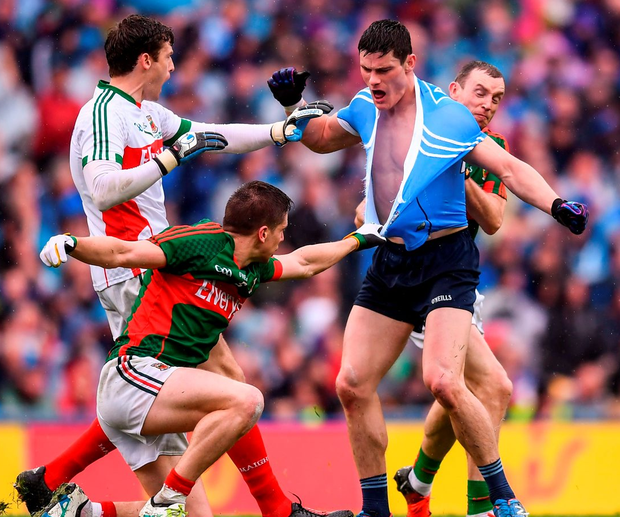 Dublin's Diarmuid Connolly has his shirt ripped as he tussles with Mayo's Lee Keegan. Photo: Stephen McCarthy/Sportsfile