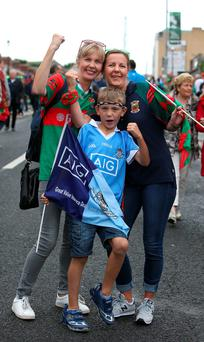 Mayo supporters Olivia Devaney (left) and Linda Cox with her son Rian Cox (8), who supports Dublin, before the All Ireland football final in Croke Park. Photo: Damien Eagers