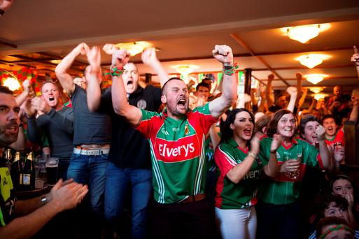 Derek Giblin (centre) with fellow Mayo supporters watching the All-Ireland final between Dublin and Mayo in Rocky's bar, Castlebar, Co Mayo. Photo: Andrew Downes
