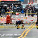 FBI officials record the spray of debris and shrapnel across the ground at the site of an explosion in the Chelsea neighbourhood of Manhattan. Photo: Rashid Umar Abbasi