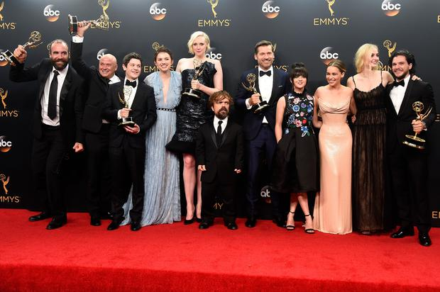 L-R) Actors Rory McCann, Conleth Hill, Iwan Rheon, Gwendoline Christie, Peter Dinklage, Nikolaj Coster-Waldau, Maisie Williams, Emilia Clarke, Sophie Turner and Kit Harington, winners of Best Drama Series for Game of Thrones. (Photo by Frazer Harrison/Getty Images)
