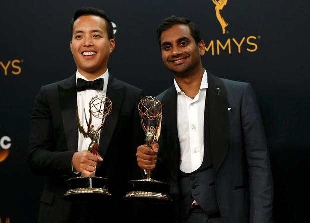 Alan Yang (L) and Aziz Ansari pose backstage with their awards for Outstanding Writing For A Comedy Series for