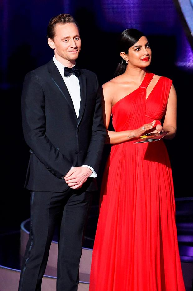 Actors Tom Hiddleston and Priyanka Chopra speak onstage during the 68th Annual Primetime Emmy Awards at Microsoft Theater on September 18, 2016 in Los Angeles, California. (Photo by Kevin Winter/Getty Images)