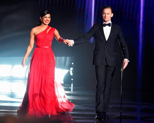 Actors Priyanka Chopra and Tom Hiddleston walk onstage during the 68th Annual Primetime Emmy Awards at Microsoft Theater on September 18, 2016 in Los Angeles, California. (Photo by Kevin Winter/Getty Images)