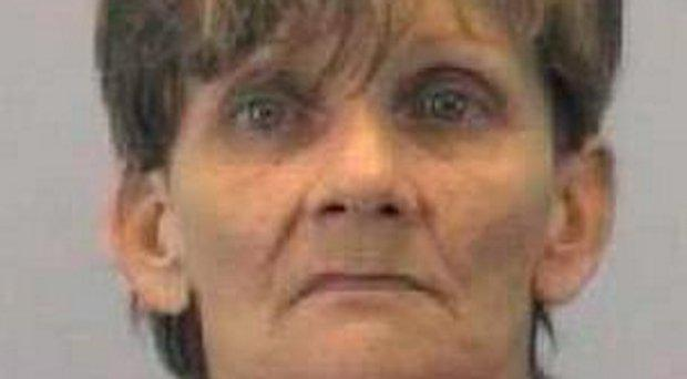 Marcella Jean Lee (56) was charged with concealing and failure to report a death