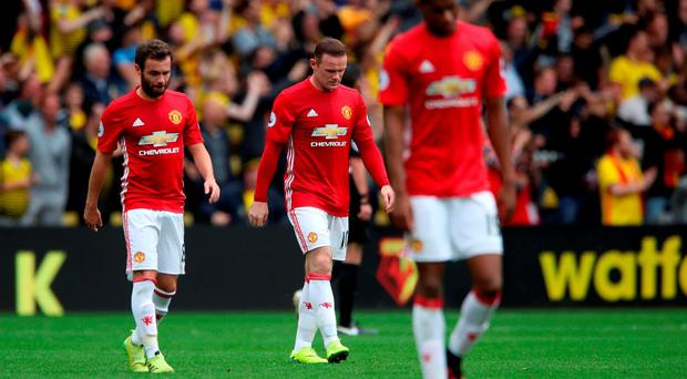 Manchester United's Wayne Rooney (centre) looks dejected at the end of the game during the Premier League match at Vicarage Road