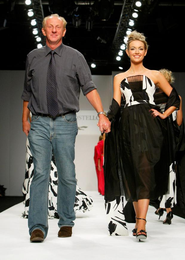 Rosanna Davison and Irish designer Paul Costelloe walk down the runway at the Paul Costelloe fashion show as part of London Fashion Week Spring/Summer 2005 at the BFC Tent, Duke of York's HQ, Kings Road on September 23, 2004 in London. (Photo by Gareth Cattermole/Getty Images)