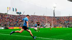 Diarmuid Connolly of Dublin kicks a sideline ball in the dying minutes