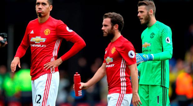 Manchester United's (L - R) Chris Smalling, Juan Mata and David de Gea look dejected after the final whistle at Watford
