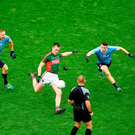 Cillian O'Connor of Mayo kicks the equalising point near the end of the All Ireland final