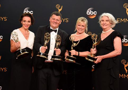 Amanda Abbington, from left, Steven Moffat, Sue Vertue, and Rebecca Eaton winners of the award for outstanding television movie for Sherlock: The Abominable Bride (Masterpiece) at the Emmys. (Photo by Jordan Strauss/Invision/AP)