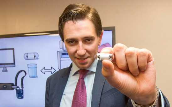 Health Minister Simon Harris holds a tiny camera pill which can be swallowed as an alternative to a colonoscopy. Photo: Mark Condren
