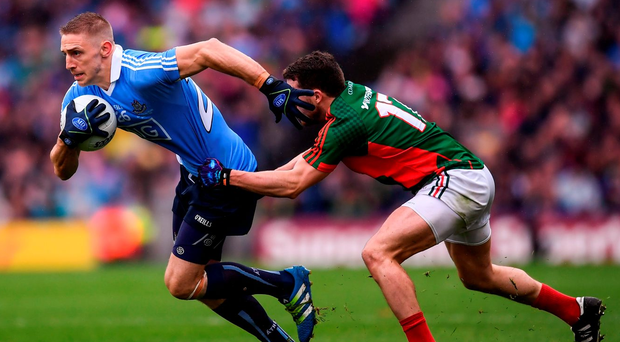 Eoghan O'Gara in action against Chris Barrett during Sunday's final. Photo: Stephen McCarthy/Sportsfile
