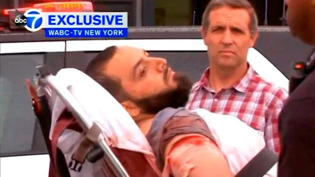 A conscious man believed to be New York bombing suspect Ahmad Khan Rahami being loaded into an ambulance after a shoot-out with police in Linden, New Jersey, U.S. Courtesy WABC-TV via Reuters