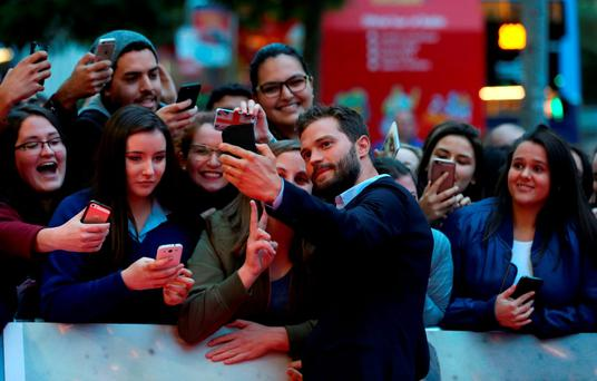 Jamie Dornan poses with fans at the premiere of 'The Siege of Jadotville' at the Savoy in Dublin Picture: PA