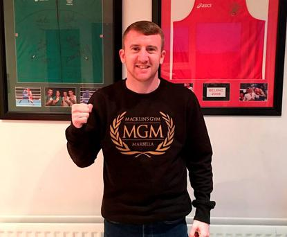 Boxer Paddy Barnes poses in an MGM gym jumper