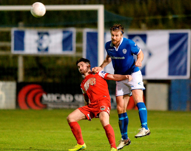 Cork City's Sean Maguire in action against Finn Harps' Keith Cowan. Photo: Oliver McVeigh/Sportsfile