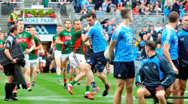 Dublin's Michael Darragh Macauley and Mayo's Keith Higgins tussle even before a ball is kicked Photo: Don MacMonagle