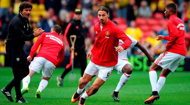 Manchester United warm up - but they don't do much running when the whistle blows