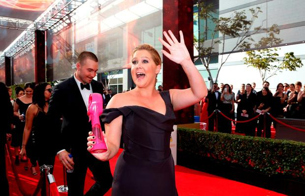 Amy Schumer arrives at the 68th Primetime Emmy Awards on Sunday, Sept. 18, 2016, at the Microsoft Theater in Los Angeles. (Photo by Rich Fury/Invision for the Television Academy/AP Images)