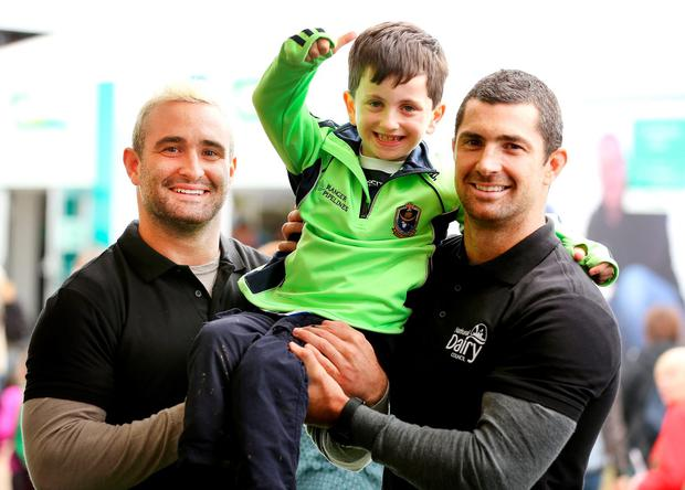 Rugby stars Rob and Dave Kearney meet Rory Doyle (7), from Knockcroghery, Co Roscommon at the Ploughing. Photo: Gerry Mooney