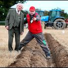 President Michael D Higgins chats with Dave Mulcahy, from Leamlara, Co Cork, who is competing at the National Ploughing Championships in Screggan, Tullamore, Co Offaly. Photo: Steve Humphreys