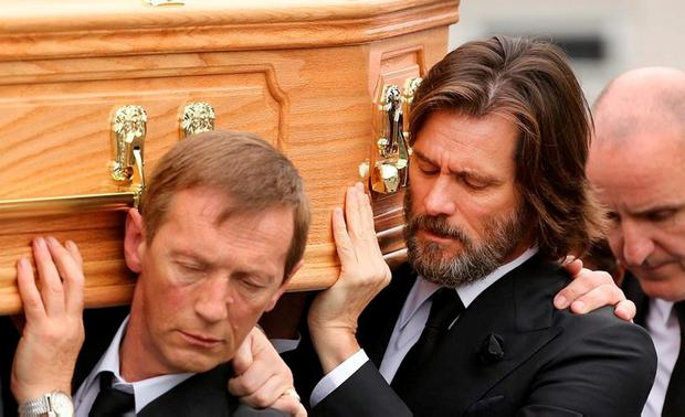 Jim Carrey helping to carry her coffin outside the church in Cappawhite, Co Tipperary, during her funeral last October. Photo: Gerry Mooney