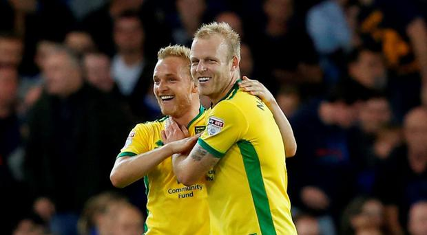 Norwich City's Steven Naismith (r) celebrates scoring their first goal with Alex Pritchard. Photo: Reuters