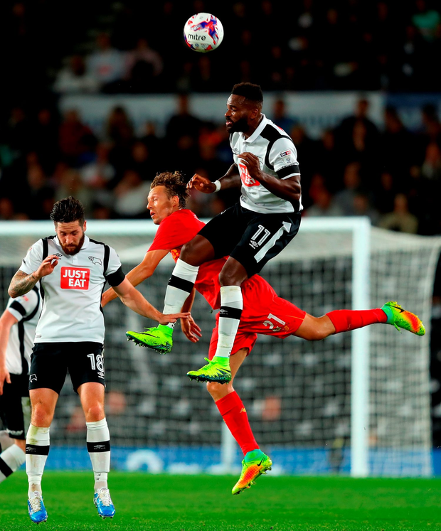Liverpool's Lucas Leiva and Derby County's Darren Bent compete for a high ball. Photo: Getty