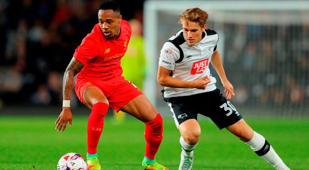 Liverpool's Nathaniel Clyne in action with Timi Elsnik. Photo: Getty