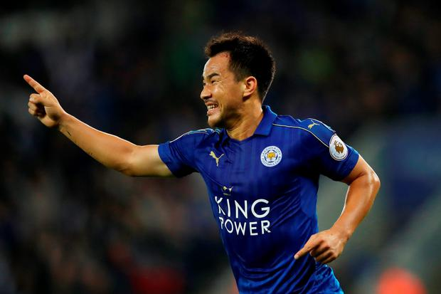 Shinji Okazaki celebrates scoring his first of two goals. Photo: Getty
