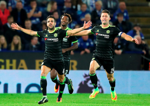 Cesc Fabregas celebrates scoring Chelsea's fourth goal in their victory over Leicester City last nightSSE. Photo: PA