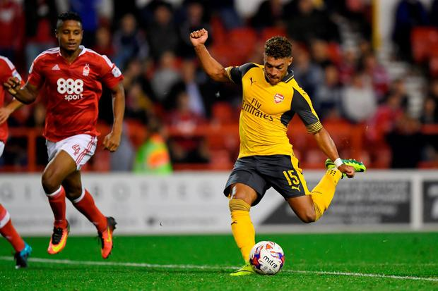 Alex Oxlade-Chamberlain scores Arsenal's fourth goal. Photo: Getty